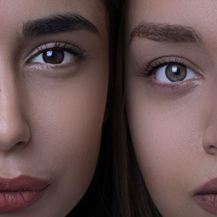 two women looking into the camera lens in a tightly cropped photo