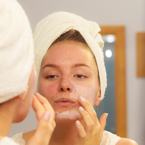 Woman applying primer